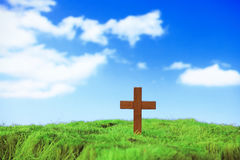 Wood cross on green grass Stock Images