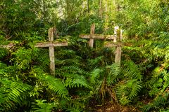 Wood cross in patagonian cementery in Chile, Caleta Tortel royalty free stock image