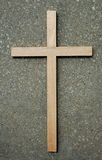 Wood Cross and Stone. Wooden Cross on stone background royalty free stock photos