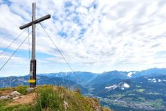 A wood cross on top of the mountain Kalmberg and rays of the sun. Beautiful landscape. Salzkammergut region stock photography