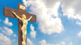 Wood crucifix the body of Christ on the cross. On the blue sky cloudy stock video footage