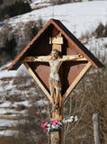 Wood crucifix with capitellum in a district of a mountain villag Royalty Free Stock Photography