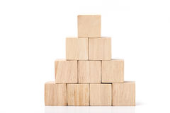 Wood cube arrange in pyramid shape ,business concpt.  Royalty Free Stock Photography