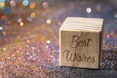 Best wishes text on cube. Wood Cube with Best wishes text on glitter royalty free stock photography