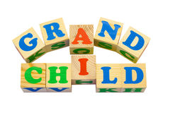 Wood cube with inscription GRANDCHILD Royalty Free Stock Images