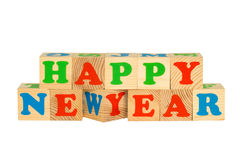 Wood cube with inscription HAPPY NEW YEAR Royalty Free Stock Images