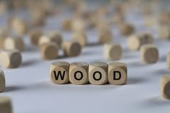 Wood - cube with letters, sign with wooden cubes royalty free stock images