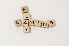 Wood cube play&gaming. Little wood cube writing the word play and gaming Stock Image