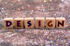 Design word. Wood Cubes design word on glitter background Royalty Free Stock Photography