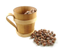 Wood cup with nuts Stock Image