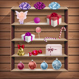 Wood cupboard with christmas gifts Royalty Free Stock Photos