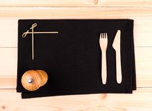 Wood cutlery on black placemat as menu board Stock Photography
