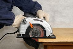 Wood cutting. With circular saw Royalty Free Stock Images