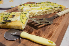 Wood cutting board with pizza and knife Royalty Free Stock Photo