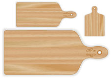 Wood Cutting Boards, Paddle Shapes. Paddle wood cutting boards, butcher block wood grain detail, small, medium, large size. For kitchen, barbecue and bar Stock Images