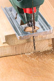 Wood cutting with electric fret-saw Stock Images
