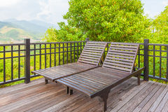 Wood daybed standing Royalty Free Stock Image
