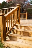 Wood deck in fall. Close shot of a new wood deck with fall colors in the background stock images