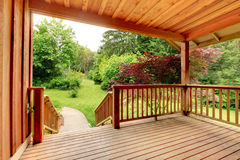 Wood deck with fence and pathed walkway. Royalty Free Stock Photo