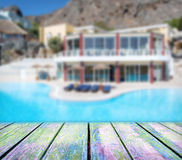 Wood deck in front of luxury hotel with pool Stock Image