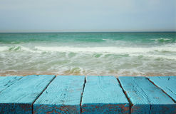 Wood deck in front of sea landscape. ready for product display royalty free stock images