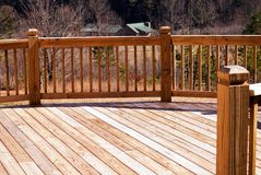 Wood deck / house in distance. A wood deck shot that shows a house in the distance stock images