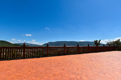 Wood deck / house in distance. View in Thailand stock photos