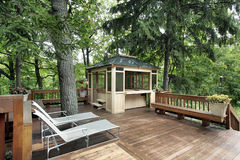 Wood deck in luxury home. Wood deck surrounded by trees in luxury home royalty free stock images