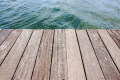 Wood deck near water Royalty Free Stock Photo