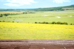 Wood deck overlooking farm landscape. With a cloudy sky stock image