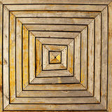 Wood Deck Pattern. A cross, or X, pattern formed by wooden boards in an uneven square shape is the basis for a wooden deck near the harbor in Puerto Baquerizo royalty free stock image