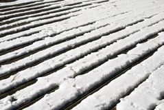 Wood deck in snow. Details of a wood deck with snow on it beginning to melt royalty free stock images
