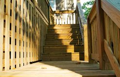 Wood deck steps. Close shot of new wood deck steps with lattice Royalty Free Stock Photo
