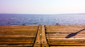 Wood deck with water view. A wood deck with a view to a enormous lake stock photos