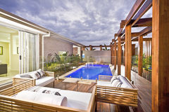 Wood decorated swimming pool area with swimming pool Stock Photos