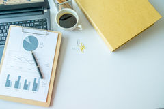 Wood desk with office supplies and red cup of coffee, top view Stock Images