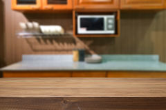 Wood desk space and blurred of kitchen background. for product d royalty free stock image