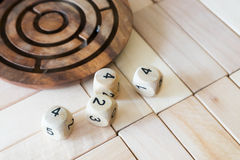 Wood dices on the puzzle wood Stock Photo