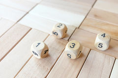 Wood dices on the puzzle wood Royalty Free Stock Images