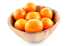 Wood dish full with oranges Royalty Free Stock Images