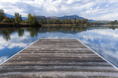 Wood dock by calm river. A wood dock by the Coeur d'Alene River near Cataldo, Idaho Royalty Free Stock Photography