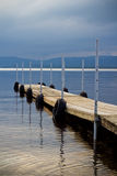 Wood dock on lake Stock Images