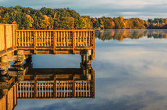 Wood Dock Over Pond Or Lake In Fall Autumn In Connecticut USA Royalty Free Stock Images