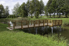 Wood dock. With rope on the pond Stock Image
