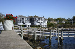 Wood dock by townhomes. Wood dock by an inlet in Stonington Connecticut Royalty Free Stock Images