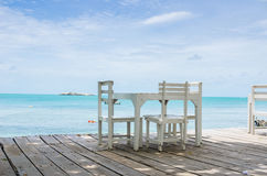 Wood dock White chair and table Royalty Free Stock Photo