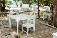 Wood dock White chair and table Stock Photo