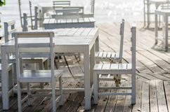 Wood dock White chair and table Stock Image