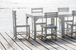 Wood dock White chair and table Royalty Free Stock Images
