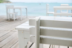 Wood dock White chair and table Stock Images